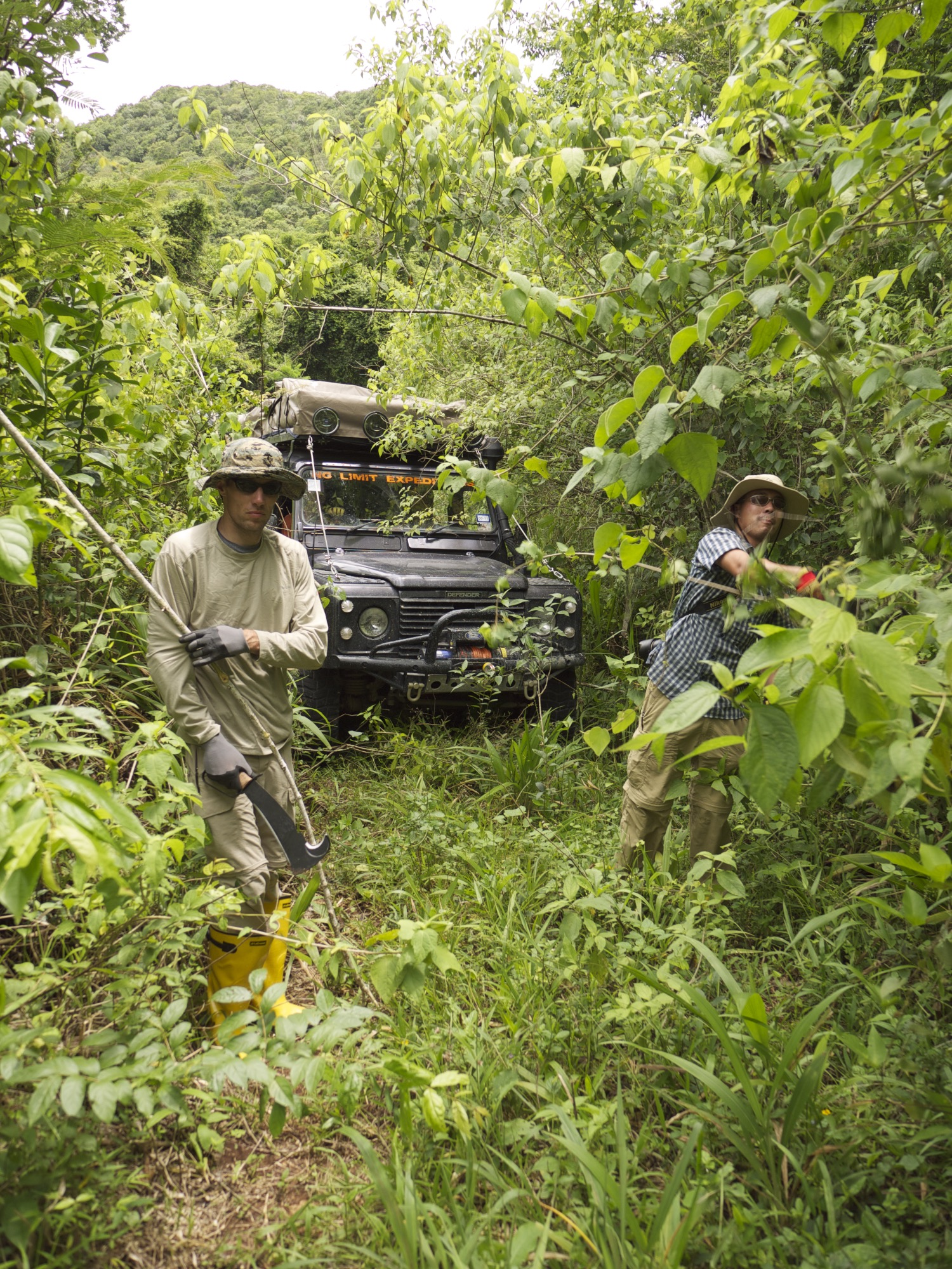 Vince and Joey clearing brush ahead of the trucks