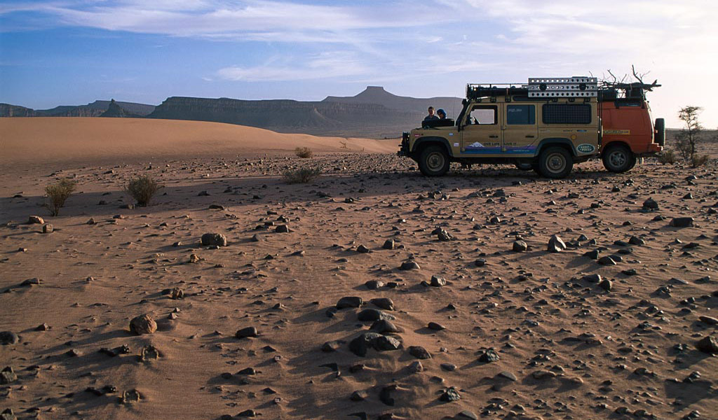 Land Rovers parked in desert