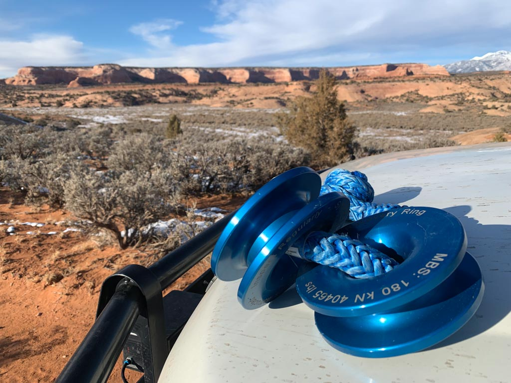 Two blue Recovery Rings on bonnet, mesa in background